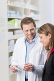 Pharmacist explaining something to a patient Royalty Free Stock Photos