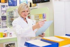Pharmacist files documents Stock Photo