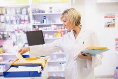 Pharmacist files documents Stock Photography