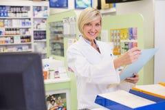 Pharmacist files documents Royalty Free Stock Photo