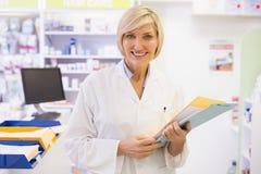 Pharmacist files documents Stock Image