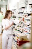 Pharmacist Filling Prescription Stock Photography