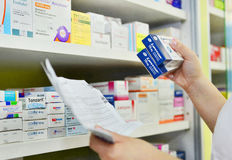 Pharmacist filling prescription, hands holding a medicine box Royalty Free Stock Image