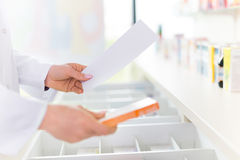 Pharmacist filling prescription Royalty Free Stock Photography