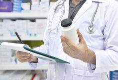 Pharmacist filling prescription Stock Photos