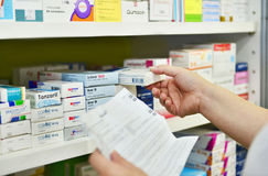 Pharmacist filling prescription stock photos
