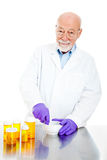 Pharmacist Filling Prescriptions Royalty Free Stock Image