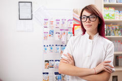 Pharmacist in front of her desk Stock Photo