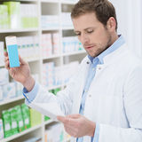 Pharmacist fulfilling a prescription Stock Photography