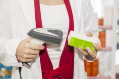 Pharmacist getting read  barcode of doctor prescription Stock Image