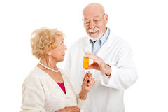 Pharmacist Giving Instructions Stock Photography