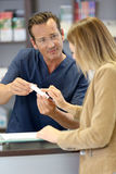 Pharmacist giving instructions on how to use medication Royalty Free Stock Images