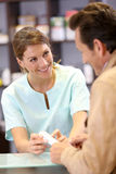 Pharmacist giving instructions to patient Stock Images