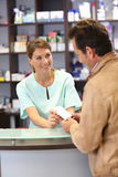 Pharmacist giving instructions to patient Royalty Free Stock Photos