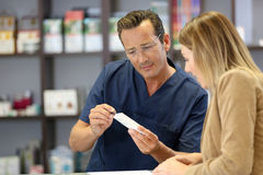 Pharmacist giving instructions to patient Royalty Free Stock Photography