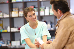 Pharmacist giving instructions on using medicines Stock Image