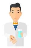Pharmacist giving pills Royalty Free Stock Images