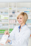 Pharmacist Giving Prescription Medicines In Pharmacy Royalty Free Stock Images