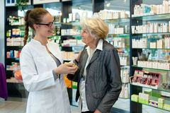 Pharmacist and grateful senior woman. Royalty Free Stock Photo