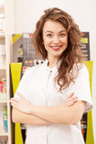 Pharmacist greeting clients with a smilie Stock Photos