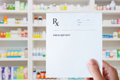 Pharmacist hand holding prescription paper in hand Royalty Free Stock Photos