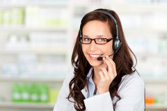 Pharmacist with headset Royalty Free Stock Photography