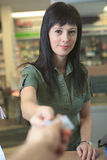 Pharmacist helping customer at counter place Royalty Free Stock Image