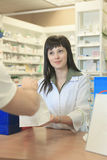 Pharmacist helping customer at counter place Stock Photo
