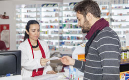Pharmacist helping customer Stock Image