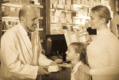 Pharmacist helping customers Stock Images