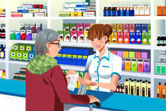 Pharmacist helping an elderly person. A vector illustration of pharmacist helping an elderly person in the pharmacy Stock Images