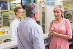 Pharmacist and her customers talking about medication Stock Photo
