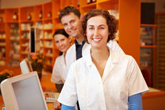 Pharmacist with her team. Happy pharmacist with her team in a pharmacy Stock Photo