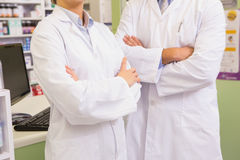Pharmacist and his trainee with arms crossed Stock Image