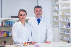 Pharmacist and his trainee looking at the camera Stock Images
