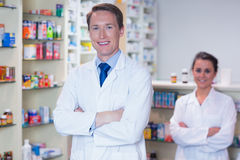 Pharmacist with his trainee standing with arms crossed Stock Photo