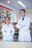 Pharmacist and his trainee standing with arms crossed Stock Image