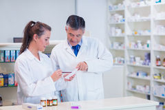 Pharmacist and his trainee working together Royalty Free Stock Images