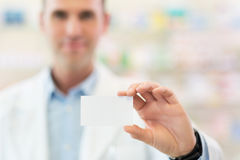 Pharmacist holding blank card Stock Images