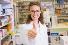 Pharmacist holding her thumb up Stock Image