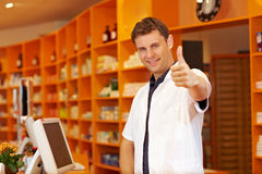 Pharmacist holding his thumbs up Stock Image