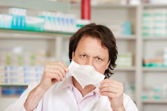 Pharmacist holding mask Stock Images