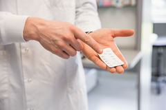 Pharmacist holding medicine blister pack Stock Photos