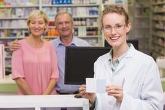 Pharmacist holding medicine box Royalty Free Stock Photos