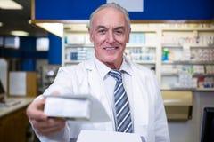 Pharmacist holding a medicine box Royalty Free Stock Image