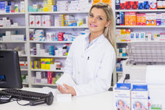 Pharmacist holding medicines looking at camera Stock Images