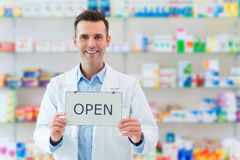Pharmacist Holding An Open Sign Royalty Free Stock Photography