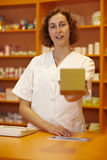 Pharmacist holding packaging Royalty Free Stock Photo