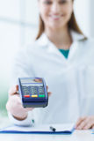 Pharmacist holding a payment terminal Royalty Free Stock Photo