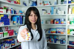 Pharmacist holding pills Stock Image